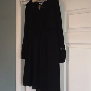 Black dress with bell sleeves and lace accents